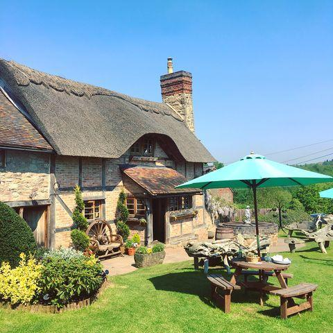 """<p>A 16th-century cider house, <a href=""""http://www.liveandletlive-bringsty.co.uk/"""" rel=""""nofollow noopener"""" target=""""_blank"""" data-ylk=""""slk:The Live and Let Live"""" class=""""link rapid-noclick-resp"""">The Live and Let Live</a> is Herefordshire's only remaining thatched-roof pub. The pub's garden is spacious with gorgeous views across Bringsty Common and the Malvern Hills. </p><p><a href=""""https://www.instagram.com/p/BifR0NsA377/?utm_source=ig_embed&utm_campaign=loading"""" rel=""""nofollow noopener"""" target=""""_blank"""" data-ylk=""""slk:See the original post on Instagram"""" class=""""link rapid-noclick-resp"""">See the original post on Instagram</a></p>"""