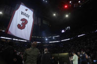 Former Miami Heat guard Dwyane Wade's jersey is hoisted to the rafters during a jersey retirement ceremony at halftime of an NBA basketball game between the Heat and the Cleveland Cavaliers, Saturday, Feb. 22, 2020, in Miami. (AP Photo/Wilfredo Lee)