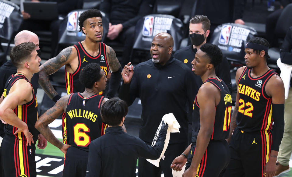 Atlanta Hawks interim coach Nate McMillan talks with Bogdan Bogdanovic, John Collins, Lou Williams, Onyeka Okongwu and Cam Reddish, from left, during a timeout in the third quarter against the Milwaukee Bucks in Game 5 of the Eastern Conference finals in the NBA basketball playoffs Thursday, July 1, 2021, in Milwaukee. (Curtis Compton/Atlanta Journal-Constitution via AP)