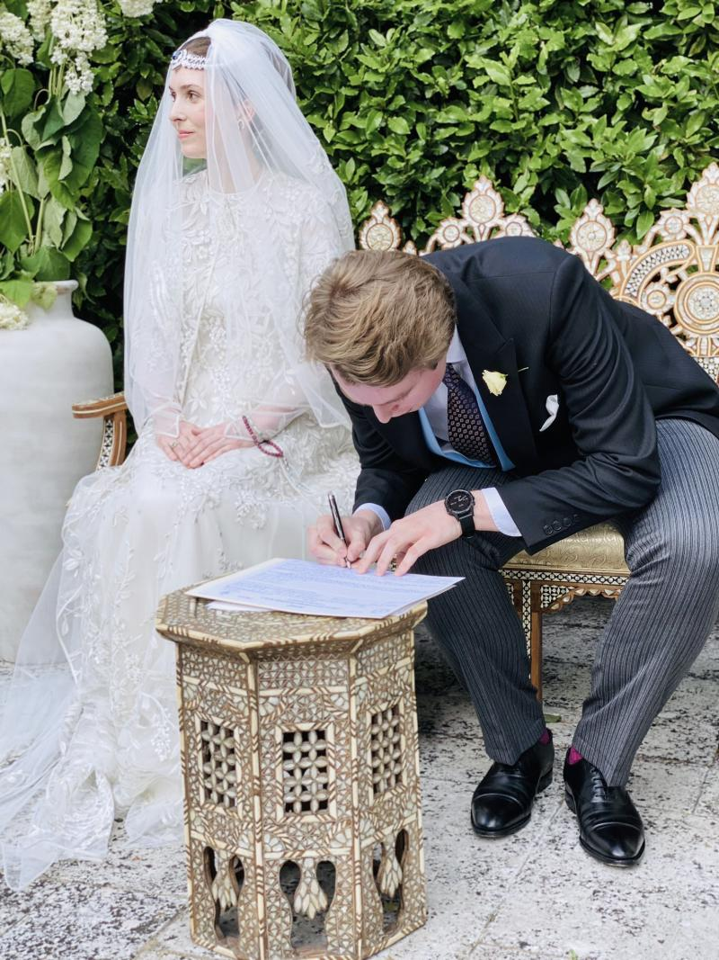 Princess Raiyah nd Ned Donovan sign wedding papers