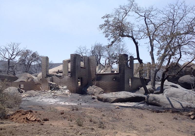 This Monday, July 1, 2013 photo made and provided by Arizona House Speaker Andy Tobin on a tour of the burn area shows the remains of a house destroyed by a wildfire in Yarnell, Ariz. The wildfire killed 19 firefighters on Sunday. (AP Photo/Courtesy Andy Tobin)