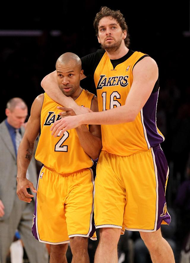 LOS ANGELES, CA - JANUARY 16: Derek Fisher #2 of the Los Angeles Lakers celebrates with Pau Gasol #16 after Fisher stole the ball and scored a break away basket against the Dallas Mavericks at Staples Center on January 16, 2012 in Los Angeles, California. The Lakers won 73-70. NOTE TO USER: User expressly acknowledges and agrees that, by downloading and or using this photograph, User is consenting to the terms and conditions of the Getty Images License Agreement. (Photo by Stephen Dunn/Getty Images)