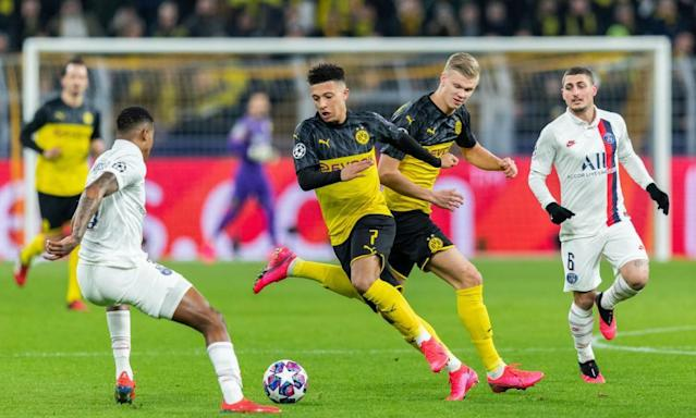 """<span class=""""element-image__caption"""">Jadon Sancho (centre left) and Erling Haaland (centre right) in action against PSG in February 2020.</span> <span class=""""element-image__credit"""">Photograph: Boris Streubel/Getty Images</span>"""