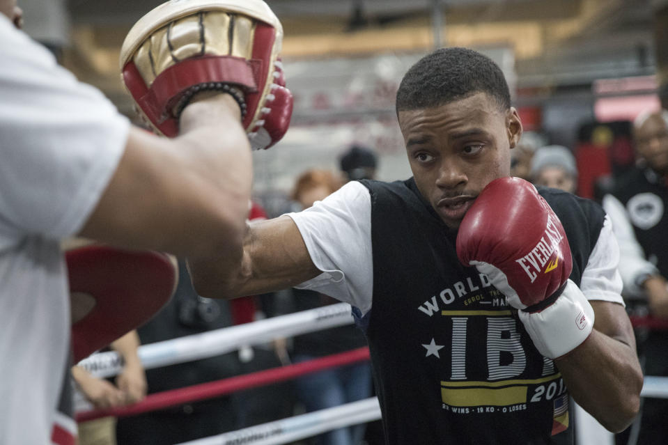 Errol Spence Jr. throws a punch while sparring with a trainer during a workout at Gleason's Gym, Wednesday, Jan. 17, 2018, in the Brooklyn borough of New York. Spence is slated to defend his IBF welterweight title against Lamont Peterson on Saturday in Brooklyn.(AP Photo/Mary Altaffer)