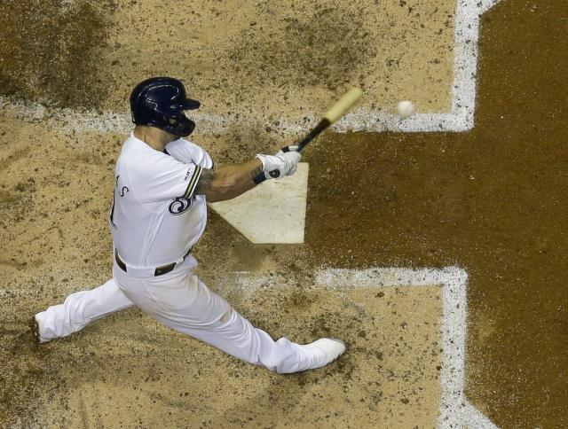 Milwaukee Brewers' Mike Moustakas hits a home run during the seventh inning of a baseball game against the San Diego Padres Tuesday, Sept. 17, 2019, in Milwaukee. (AP Photo/Morry Gash)