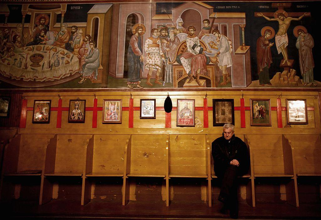 BOSNIA AND HERZEGOVINA: Bosnian Serbs sit in church on the eve of Orthodox Christmas in the central Bosnian town of Zenica January 6, 2013.  Orthodox Christians mark Christmas according to the Julian calendar on January 7.