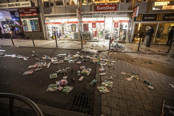 Goods lie on the floor after people broke into a shop on Marienstrasse in Stuttgart, Germany, Sunday, June 21, 2020. Dozens of violent small groups devastated downtown Stuttgart on Sunday night and injured several police officers, German news agency DPA reported. (Simon Adomat/dpa via AP)