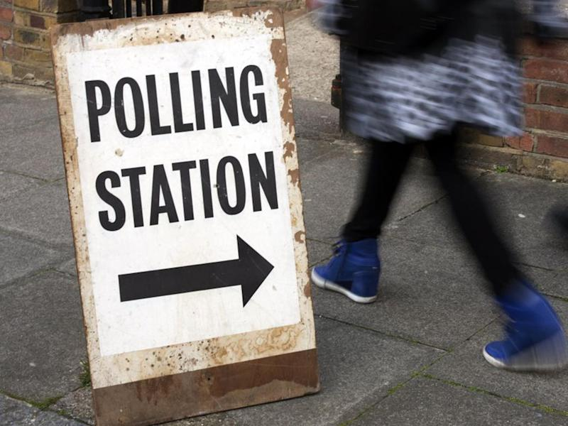People pass a polling station sign in Brixton in 2015 (file photo): EPA