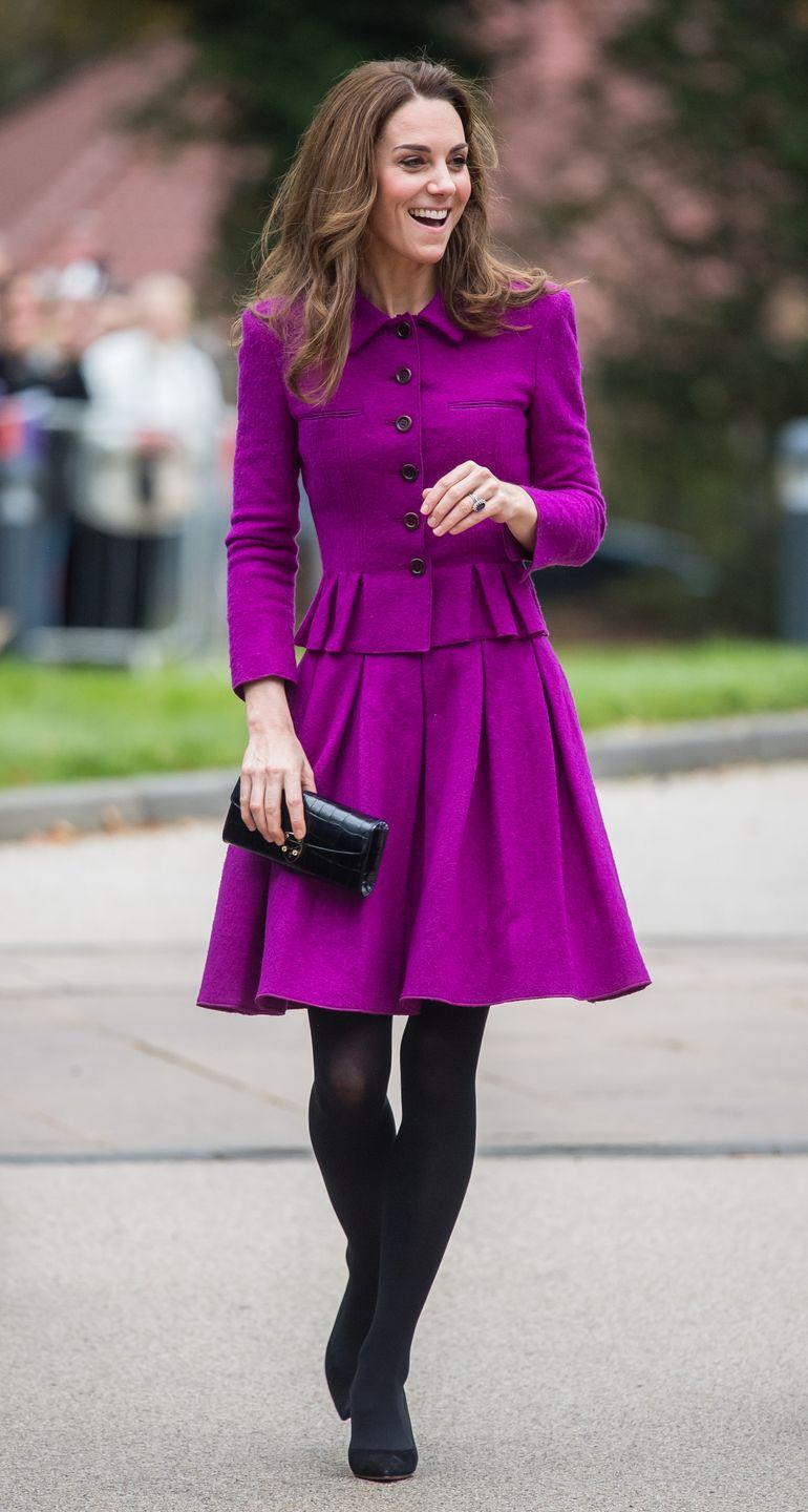 <p>Clearly one of her favourite skirt suits, Kate wore this fuchsia Oscar de la Renta look to open the Nook Children Hospice in Norfolk.</p>