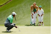 <p>Tiger Woods's children, son Charlie and daughter Sam, and his girlfriend Lindsey Vonn join him on the green as he competes in The Masters in 2015. </p>