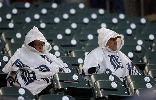 Fans wait out a rain delay before a baseball game between the Detroit Tigers and the Kansas City Royals in Detroit, Tuesday, April 23, 2013. (AP Photo/Carlos Osorio)