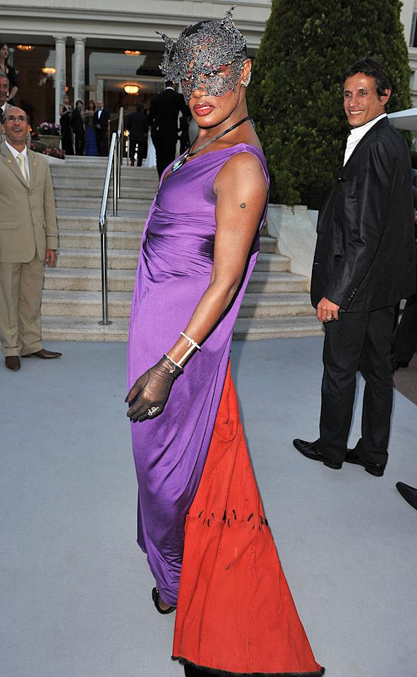"""Grace Jones -- wearing a purple dress (complete with a ratty red train) -- snarled at photographers from behind a dazzling face mask. She may be 62, but you can still count on the singer/actress/model to deliver some drama! Pascal Le Segretain/<a href=""""http://www.gettyimages.com/"""" target=""""new"""">GettyImages.com</a> - May 20, 2010"""