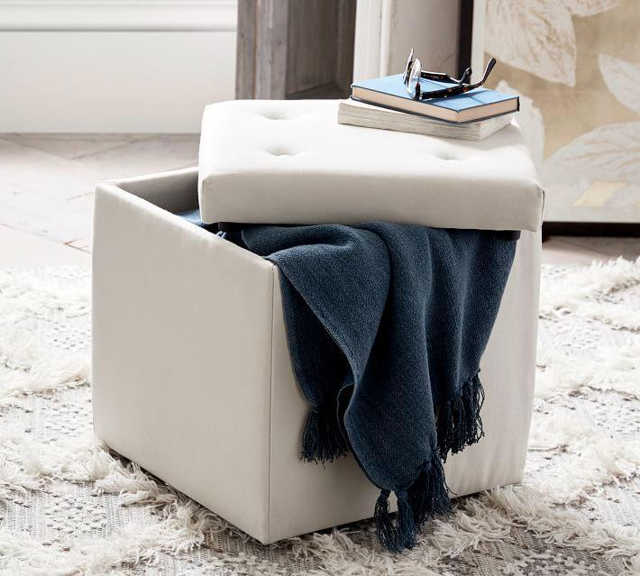 "<p>A lidded storage cube becomes a handy spot for storing just about anything, from extra blankets and sheets to shoes or video games. Choose one in a muted color with elevated details—like a tufted button top and engineered hardwood frame—so that it will last long after you've moved into your first apartment.</p> <p><strong><em>Shop Now:</em></strong><em> Pottery Barn ""Marlow"" Storage Cube, from $129, <a href=""http://pottery-barn.7eer.net/c/249354/267848/4332?subId1=MSL21DormRoomStorageIdeasThatMaketheMostofYourSmallSpacesbamseyStoGal7846410202007I&u=https%3A%2F%2Fwww.potterybarn.com%2Fproducts%2Fmarlow-storage-cube%2F"" rel=""nofollow noopener"" target=""_blank"" data-ylk=""slk:potterybarn.com"" class=""link rapid-noclick-resp"">potterybarn.com</a>.</em></p>"