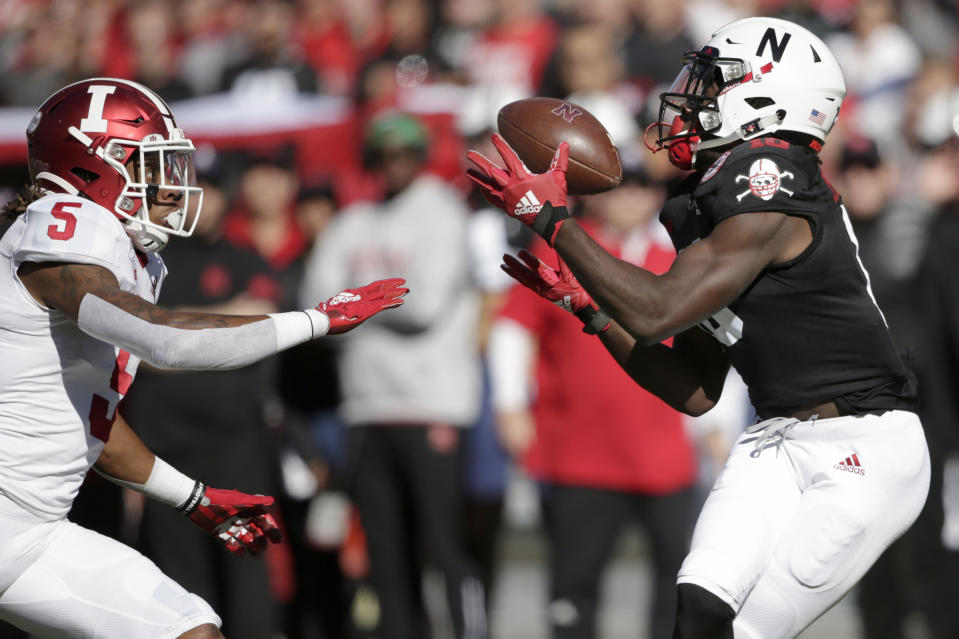 Nebraska wide receiver JD Spielman, right, makes a catch in front of Indiana defensive back Juwan Burgess (5) during the first half of an NCAA college football game in Lincoln, Neb., Saturday, Oct. 26, 2019. (AP Photo/Nati Harnik)
