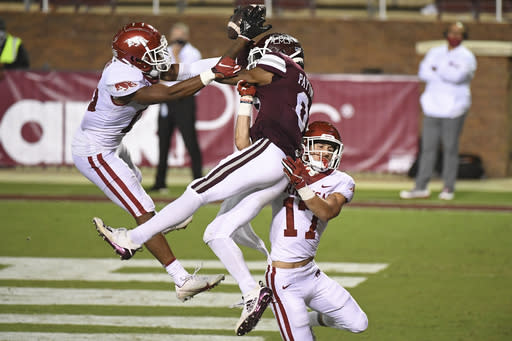 Arkansas defensive backs Simeon Blair (15) and Hudson Clark (17) break up a pass intended for Mississippi State wide receiver JaVonta Payton (0) during the second half of an NCAA college football game in Starkville, Miss., Saturday, Oct. 3, 2020. Arkansas won 21-14. (AP Photo/Thomas Graning)