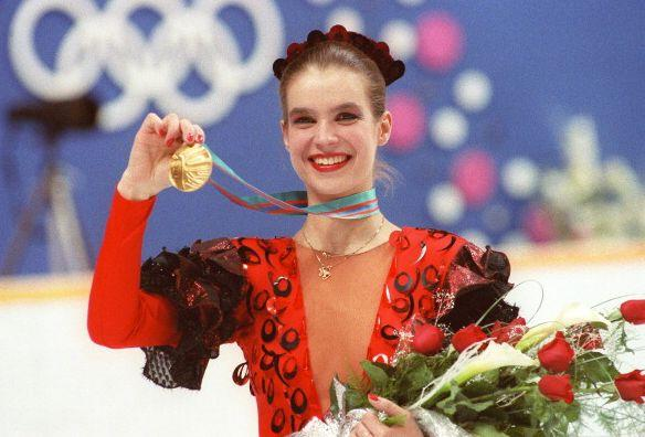 """With the Cold War in full-swing, Witt joined a rarefied group of men and women who've taken the top prize in <a href=""""http://www.biography.com/people/katarina-witt-9535264"""" rel=""""nofollow noopener"""" target=""""_blank"""" data-ylk=""""slk:back-to-back Olympics"""" class=""""link rapid-noclick-resp"""">back-to-back Olympics</a>, winning gold in 1984 and then again in 1988 (in a <em>deliciously</em> '80s costume) -- for what was then East Germany. During her reign, Witt basically owned figure skating: She was also a four-time World Champion, six-time European Champion and eight-time National Champion, before turning pro in 1988, one year before the fall of the Berlin wall."""