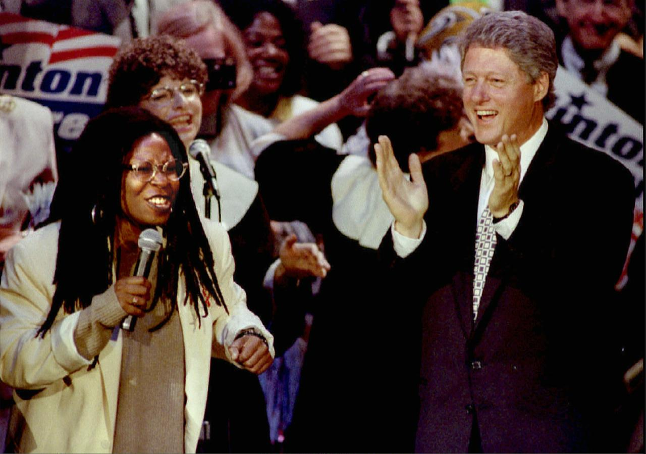 Bill Clinton shares the stage with entertainer Whoopi Goldberg during a rally for his Presidential election campaign in October, 1992.<br><br>(REUTERS/Lee Celano)