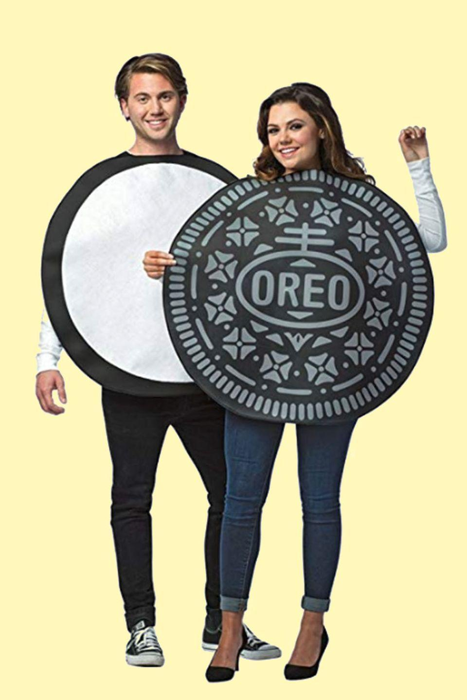 """<p>Give it up for milk's favorite cookie! Sandwiched together, you and your partner instantly become the double-stuffed variety. </p><p><a class=""""link rapid-noclick-resp"""" href=""""https://www.amazon.com/Faerynicethings-Adult-Cookie-Couples-Costume/dp/B074WGGZBF/ref=sr_1_3?tag=syn-yahoo-20&ascsubtag=%5Bartid%7C10055.g.2625%5Bsrc%7Cyahoo-us"""" rel=""""nofollow noopener"""" target=""""_blank"""" data-ylk=""""slk:SHOP OREO COSTUME"""">SHOP OREO COSTUME</a></p>"""