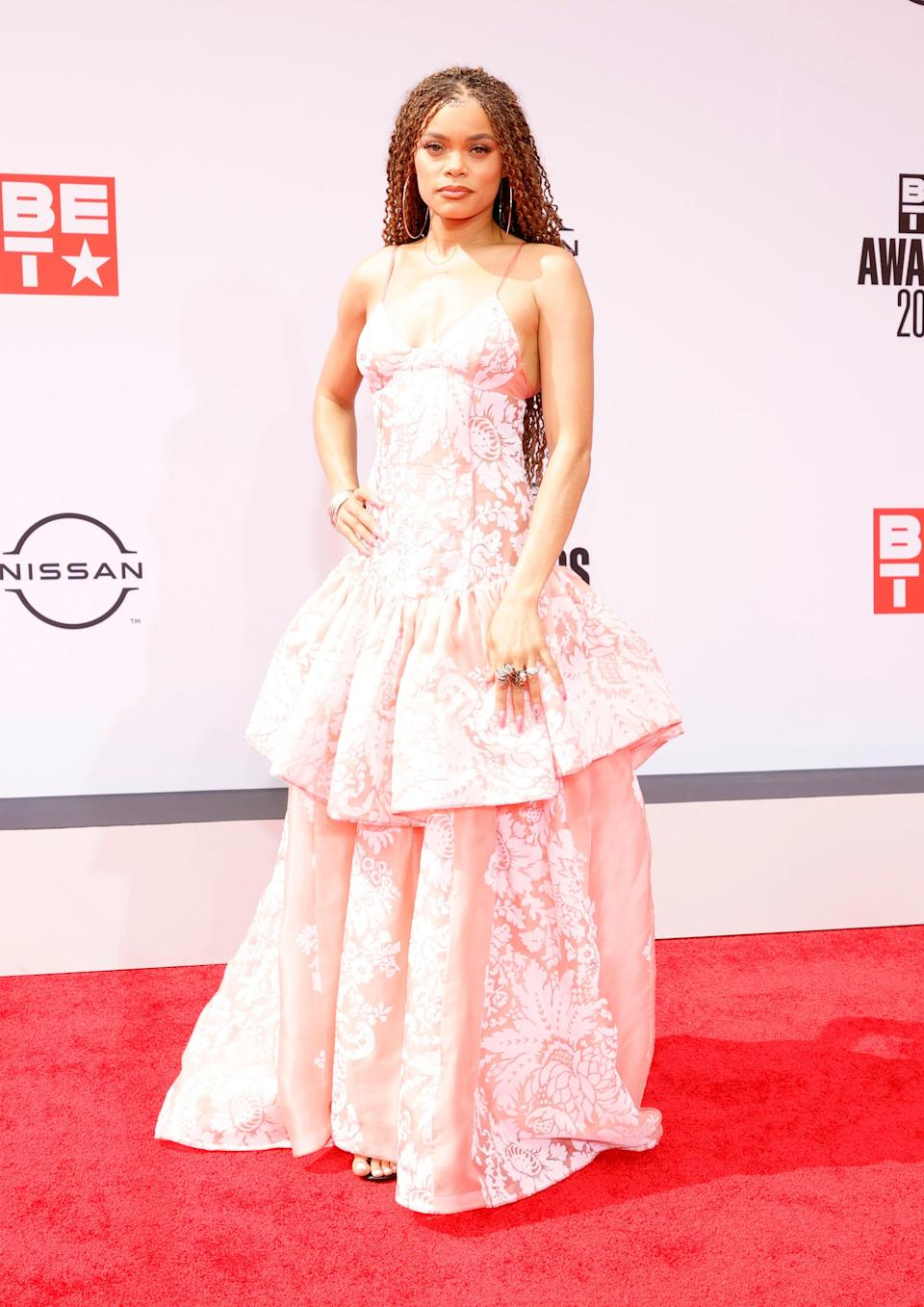 <em>The United States vs Billie Holiday</em> star Andra Day showed up to the awards show in a powder pink Rosie Assoulin gown.