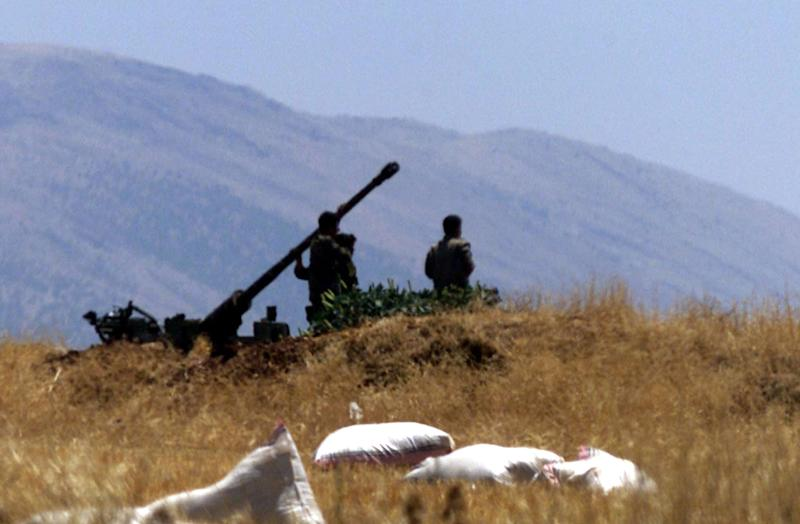FILE -- In this July 1, 2001 file photo, Syrian soldiers prepare an anti-aircraft gun near field of wheat close to a radar position in eastern Lebanon's Bekaa valley. Any international military action against Syria's regime over its reported use of chemical weapons would run up against one of the Middle East's most formidable air defenses. Syrian leader Bashar Assad has modernized the system since 2007, going on a buying spree for new Russian missiles to complement thousands of anti-aircraft guns to give multi-layer protection to strategic locations _ likely a key consideration as President Barack Obama weighs the options. (AP Photo, File)
