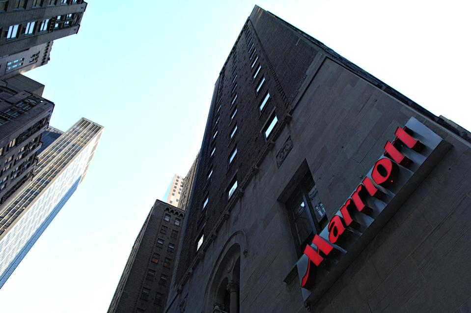 UNITED STATES - FEBRUARY 09: A Marriott logo hangs on the side of a hotel in New York Thursday, February 9, 2006. Marriott International Inc., the largest U.S. hotel operator, said fourth-quarter profit rose 25 percent on an increase in business travel and higher rates. The shares rose 3.5 percent after earnings beat analysts' estimates. (Photo by Daniel Acker/Bloomberg via Getty Images)