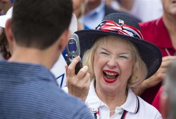 A supporter of Paul Ryan takes his photo as he works the rope line during during a campaign event at The Villages in Lady Lake, Florida August 18, 2012.