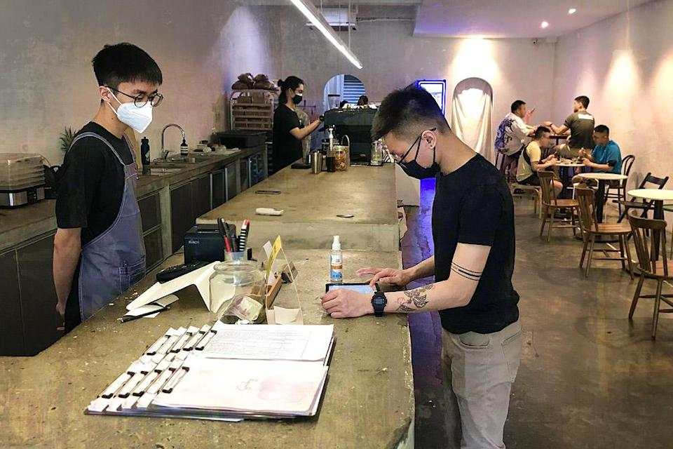 Barista Darren Lee (third from left) checking orders at Sunday Coffee & Cakes in Taman Bukit Indah, OUG.