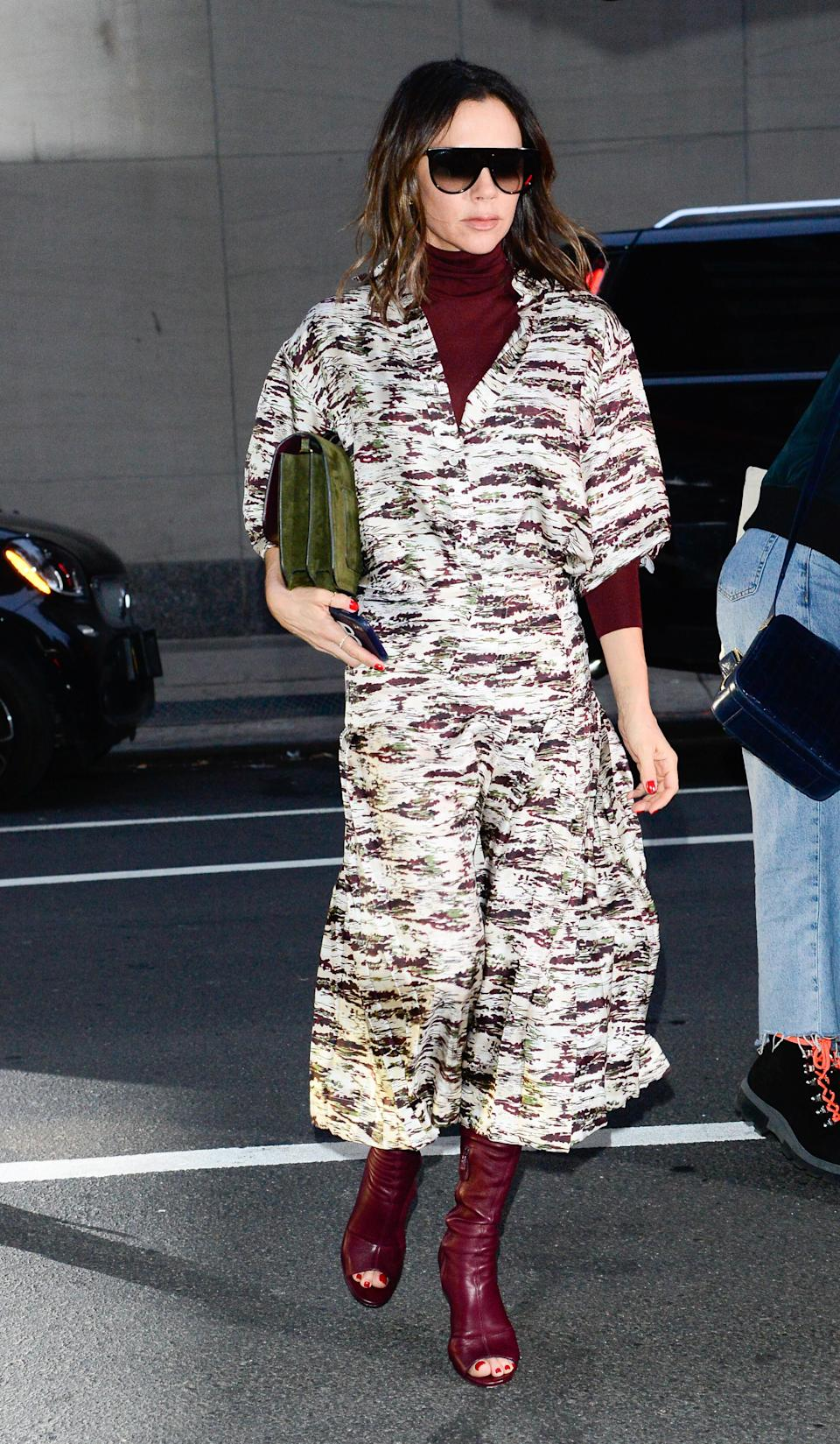 <p>On January 23, Victoria Beckham reminded us she's the ultimate street style star in a printed dress from her eponymous label teamed with burgundy open-toe boots and a matching polo. <em>[Photo: Getty]</em> </p>