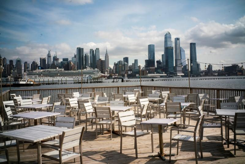 FILE PHOTO: Empty chairs are seen at the deck of a local restaurant that is closed due to the outbreak of coronavirus disease (COVID-19), in Hoboken