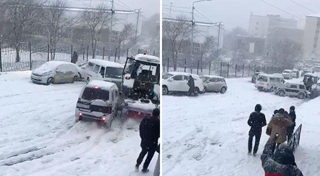 The three cars slide down the icy road. Source: Jukin
