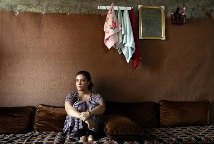 Yazidi teenager Jihan Qassem faced an impossible choice after being freed from years as a hostage of the Islamic State group, abandon her three young children fathered by a jihadist fighter or risk being ostracised by her community (AFP Photo/SAFIN HAMED)
