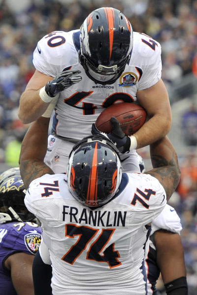 Denver Broncos running back Jacob Hester to lifted into the air my teammate tackle Orlando Franklin after scoring a touchdown during the first half of an NFL football game against the Baltimore Ravens in Baltimore, Sunday, Dec. 16, 2012. (AP Photo/Gail Burton)