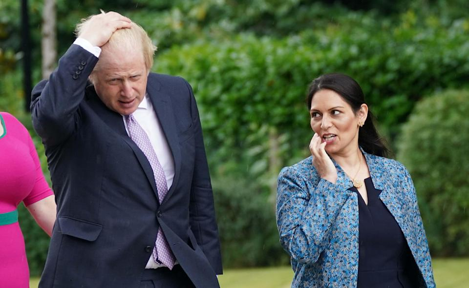 Prime Minister Boris Johnson and Home Secretary Priti Patel during a visit to Surrey Police headquarters to coincide with the publication of the government's Beating Crime Plan (PA) (PA Wire)