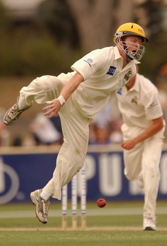 SYDNEY - JANUARY 23:  Chris Rogers of the Warriors is hit in the shin while fielding during the first day of the Pura Cup match between the New South Wales Blues and the Western Australian Warriors at Newcastle Oval in Newcastle, Australia on January 23, 2003. (Photo by Chris McGrath/Getty Images)