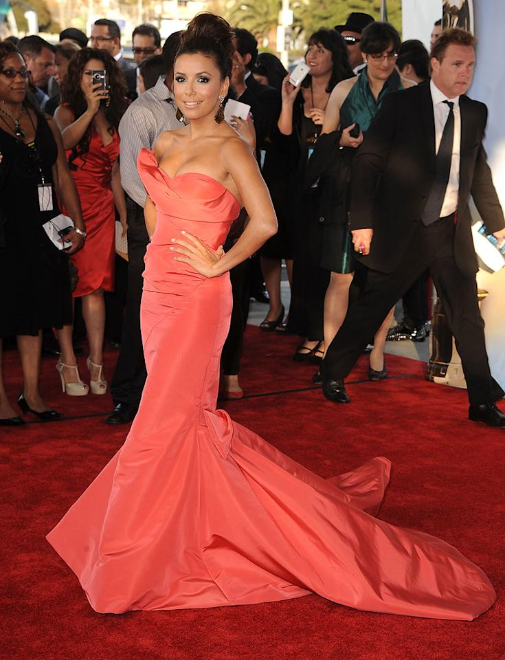"The 2011 ALMA Awards were co-hosted by ""Desperate Housewives"" diva Eva Longoria, who rocked the red carpet in a coral-colored Oscar de la Renta showstopper, which featured a ruched bodice and lengthy train. Steve Granitz/<a href=""http://www.wireimage.com"" target=""new"">WireImage.com</a> - September 10, 2011"