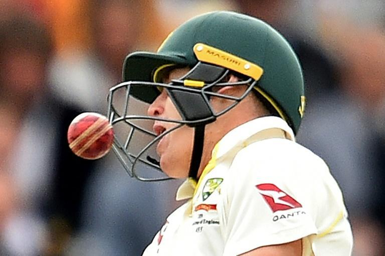 Australia's Marnus Labuschagne reacts as the ball, bowled by England's Jofra Archer hits him on the helmet (AFP Photo/Glyn KIRK )