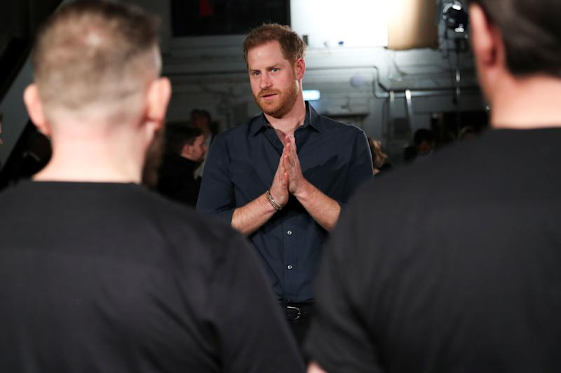 Britain's Prince Harry, Duke of Sussex chats with members of the Invictus Games Choir during his meeting with US singer Jon Bon Jovi at Abbey Road Studios in London on February 28, 2020, where they were to record a special single in aid of the Invictus Games Foundation.