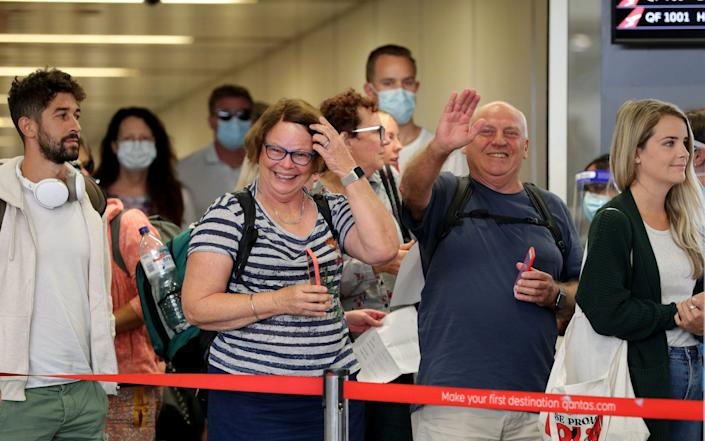 Passengers from Brisbane arrive at Perth domestic Airport after the state's hard borders come down - RICHARD WAINWRIGHT/EPA-EFE/Shutterstock