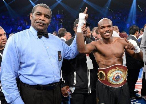 """Timothy Bradley (R) has his hand raised in victory after defeating Manny Pacquiao by split decision to win the WBO welterweight title on June 9. """"He's a strong puncher, he rocked me a couple of times in the fight, but I held my ground and fought to the end. This is boxing,"""" Bradley said"""