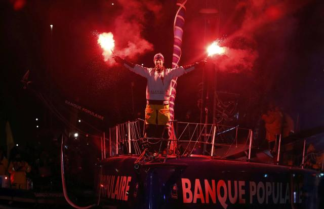 French skipper Armel Le Cleac'h reacts with flares to celebrate his winning the solo round-the-world Vendee Globe sailing race, as he arrives in the port of Les Sables d'Olonne on France's Atlantic coast January 19, 2017. REUTERS/Regis Duvignau