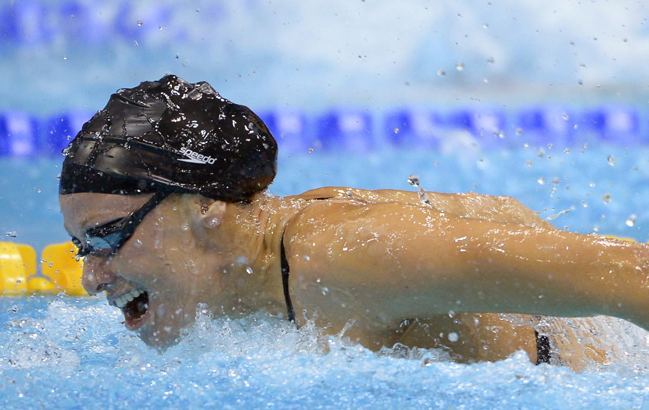United States' Dana Vollmer competes in the women's 100-meter butterfly swimming final at the Aquatics Centre in the Olympic Park during the 2012 Summer Olympics in London, Sunday, July 29, 2012. Vollmer set a new world record with a time of 55.98 (AP Photo/Mark J. Terrill)