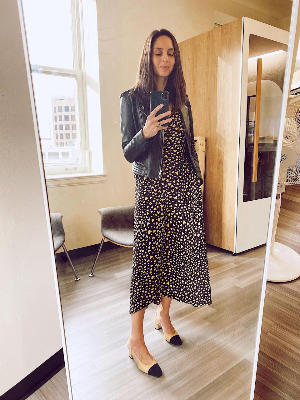"""<p>""""The muted color combo and calf-grazing length of this dress perfectly elevate the playful heart print. I picked up on the colors by styling it with two-tone mules and a leather jacket."""" - Dana Avidan Cohn, executive style director</p>"""