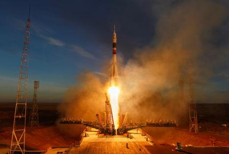 FILE PHOTO: The Soyuz MS-11 spacecraft carrying the crew formed of David Saint-Jacques of Canada, Oleg Kononenko of Russia and Anne McClain of the U.S. blasts off to the International Space Station (ISS) from the launchpad at the Baikonur Cosmodrome, Kazakhstan December 3, 2018. REUTERS/Shamil Zhumatov