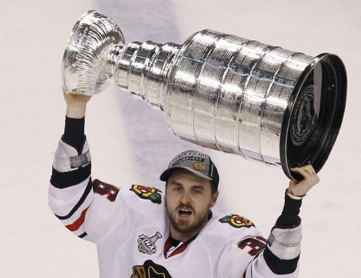 Chicago Blackhawks' Dave Bolland celebrates with the Stanley Cup after the Blackhawks defeated the Boston Bruins in Game 6 of their NHL Stanley Cup Finals hockey series in Boston, Massachusetts, June 24, 2013. REUTERS/Adam Hunger