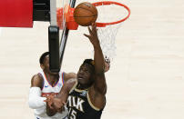 Atlanta Hawks' Clint Capela (15) shoots and scores against the New York Knicks during the first half in Game 4 of an NBA basketball first-round playoff series Sunday, May 30, 2021, in Atlanta. (AP Photo/Brynn Anderson)