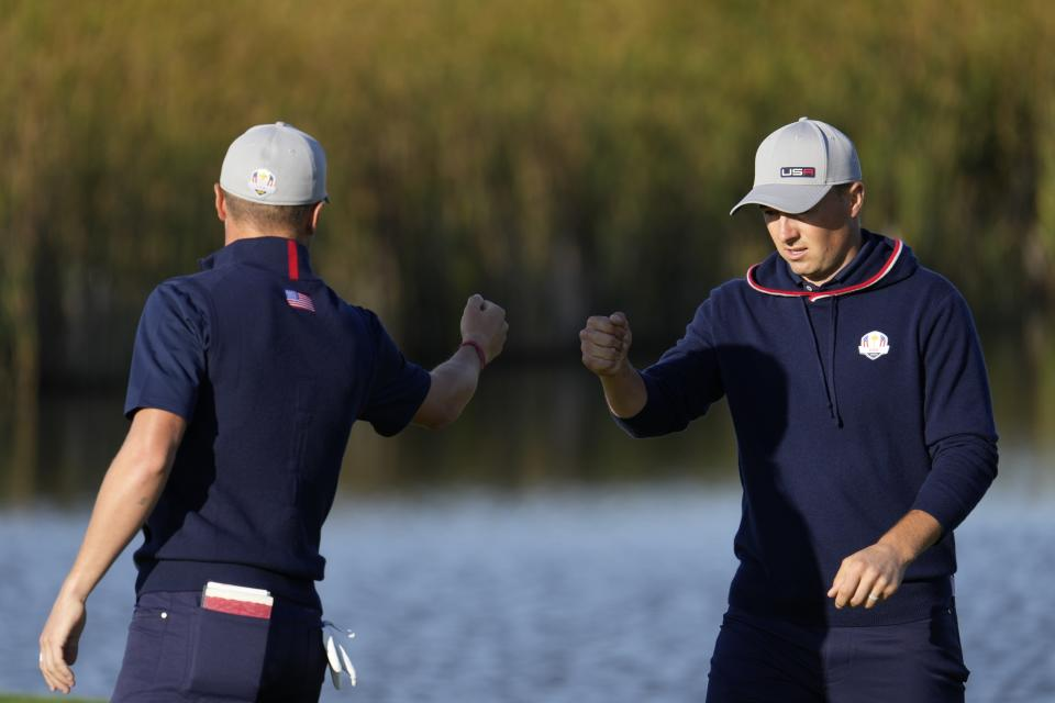Team USA's Justin Thomas and Team USA's Jordan Spieth fist pump on the fifth hole during a foursome match the Ryder Cup at the Whistling Straits Golf Course Friday, Sept. 24, 2021, in Sheboygan, Wis. (AP Photo/Ashley Landis)