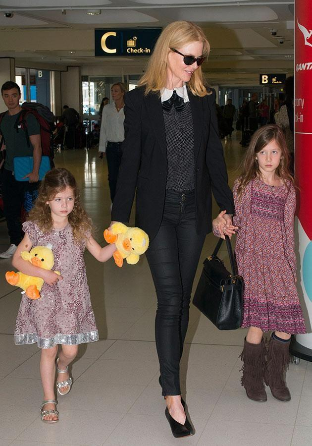 Nic, seen with daughters Sunday and Faith, says she tells them it's 'kissy-kissy' time to get privacy. Source: Splash.