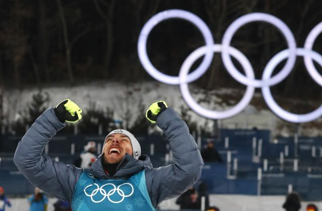 Nordic Combined Events - Pyeongchang 2018 Winter Olympics - Men's Individual 10 km Final - Alpensia Cross-Country Skiing Centre - Pyeongchang, South Korea - February 20, 2018 - Gold medalist Johannes Rydzek of Germany celebrates during the victory ceremony. REUTERS/Kai Pfaffenbach