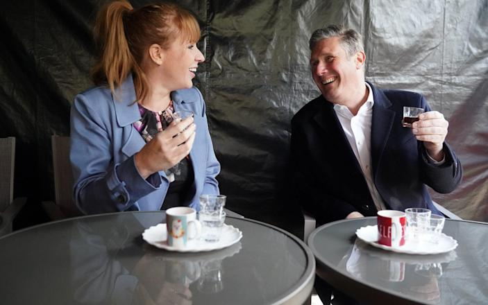 Sir Keir Starmer and Angela Rayner enjoy non-alcholic drinks during a visit to a temperance bar - Getty