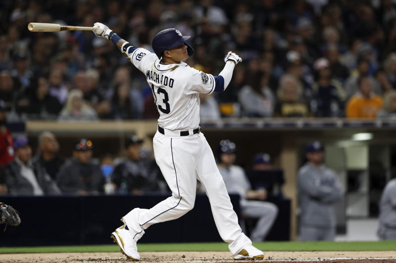 San Diego Padres' Manny Machado watches his home run during the third inning of a baseball game against the Milwaukee Brewers, Monday, June 17, 2019, in San Diego. (AP Photo/Gregory Bull)
